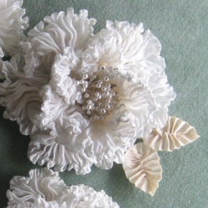 white pleated Georgette flowers, ribbons, flower stamens  and other supplies.