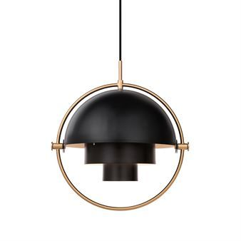 The Multi-Lite ceiling lamp from Gubi was designed in 1972 by Louis Weisdorf. The characteristic shape is typical for classic Danish design and the lamp can be, as the name suggests, used in several different ways. The lamp is made of two separate shades that can be rotated to create different combinations. This way, the light can be directly up, down or asymmetrically sideways. The lamp is available in different colors and all shades are white on the inside.