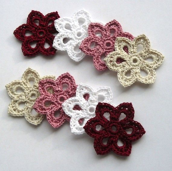 Crochet flowers, these are lovely. Leads to an etsy listing... I need to find a pattern!