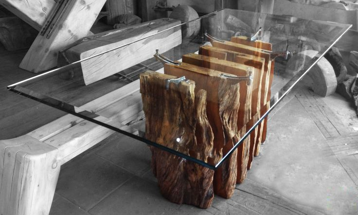 Natural Olive Table by Kala (Turkey). Series of vertical slabs of olive wood support a glass top.