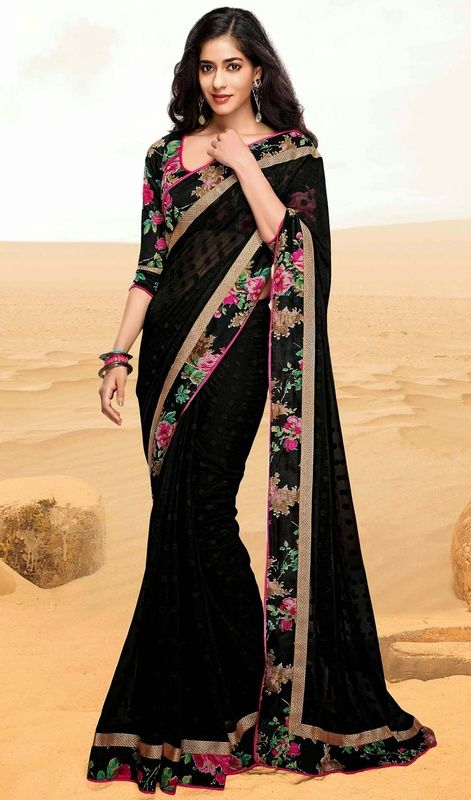 Stunning black georgette printed sari with blouse gives you grand and exquisite look. The casual printed sari is garnished with golden woven lace, polka dots and floral printed border which enhances the look. The sari pairs with matching stitched blouse as shown in the picture. #LovelyPrintedSarees