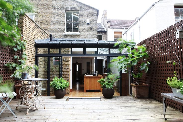 Another extension project that features a brick dwelling with black framing. The use of glass would make for a wonderful sun room or open kitchen.