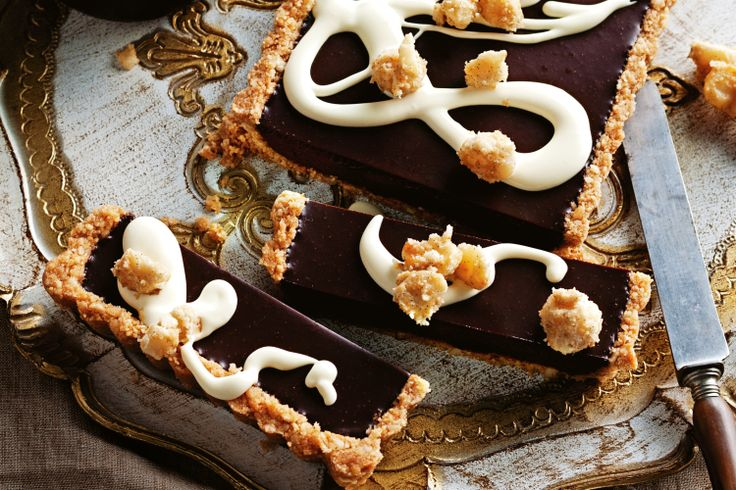 Aussie Christmas dessert is all wrapped up with this elegant creation of rum-laced ganache in a honey biscuit shell. Top it with made-ahead toffee macadamias and a trickle of double cream.