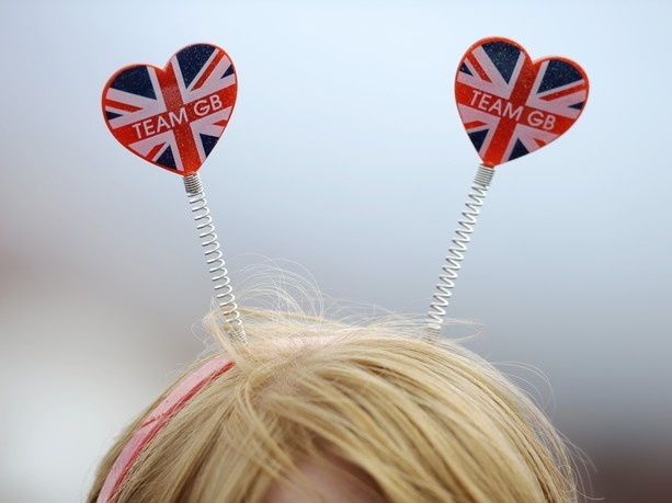 A fan of Great Britain's Olympic team wears a head piece demonstrating her allegiance at the rowing venue in Eton Dorney, near Windsor,