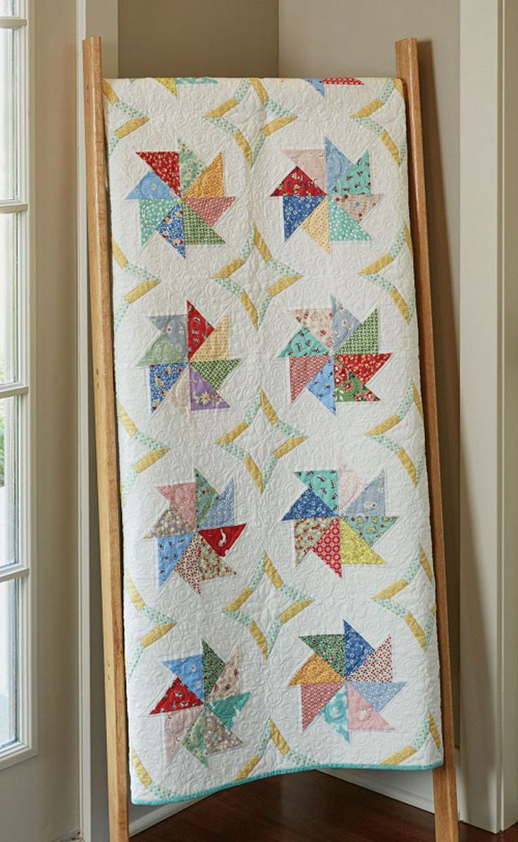 """Spinning Pinwheels Quilt Kit: Use paper foundation piecing to make this pretty pinwheel quilt featuring 1930s prints. The quilt measures 48"""" x 60"""" and was designed by Nancy Mahoney."""