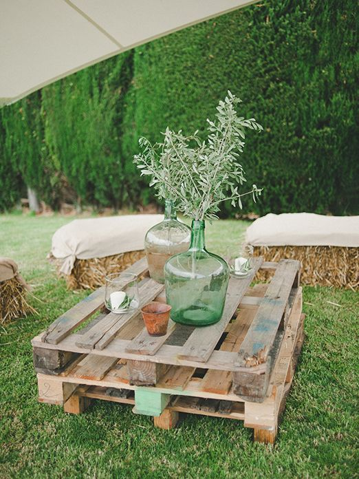 Natural organic wedding decor with olive branches and rustic pallets // photography