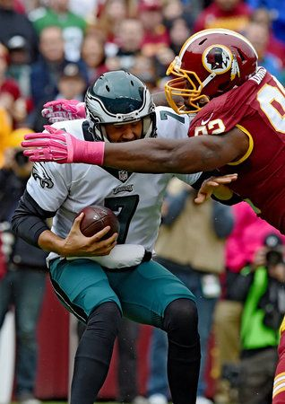 Redskins 23, Eagles 20 -   Eagles quarterback Sam Bradford gets sacked by Washington defensive lineman Chris Baker in the 1st quarter of the game October 4, 2015 at FedEx Field. Bradford was sacked five times as Washington beat the Eagles 23-20. ( CLEM MURRAY / Staff Photographer ) (The Philadelphia Inquirer)
