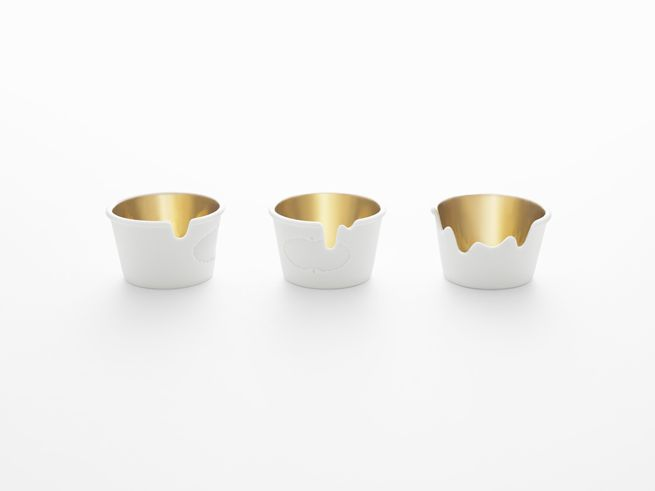 "Nendo for Haagen Dazs. ""We recreated the ice cream makers' paper cup, lid and accompanying plastic spoon as ceramics, and added 'melting ice cream' details to imitate a pot of vanilla ice cream."""
