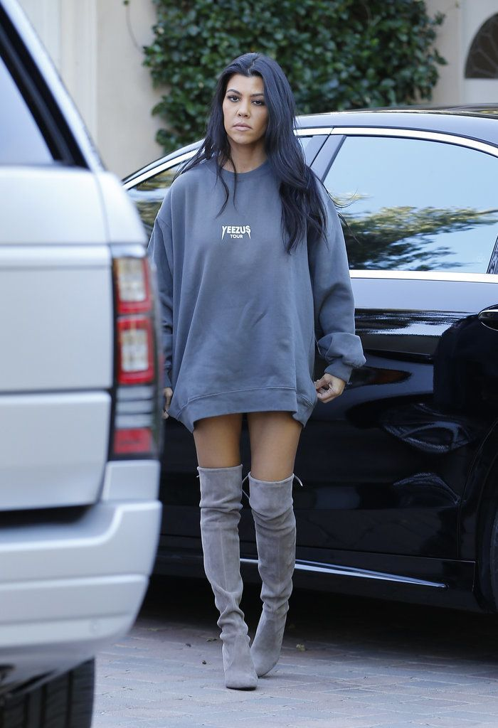 Kourtney Kardashian knows how to rock an oversized sweater and knee-high boots