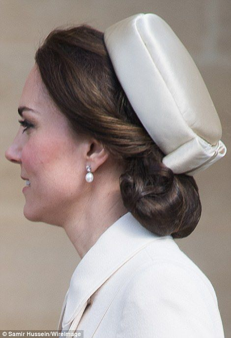 The Duchess of Cambridge close-up profile of hair up-do, earrings, hat, collar of coat, ivory, cream, creme, off-white. elegant, Catherine Easter April 16 2017