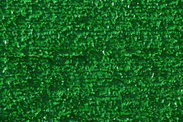 How to Install Fake Turf on a Dirt Surface