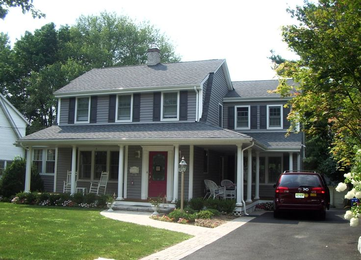 Addition and alteration to Dutch Colonial home including new