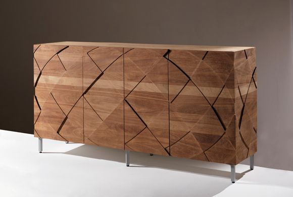 Sedici is a storage unit made in solid wood and with an extremely regular shape. All the parts of this piece of furniture are assembled with cuts of 45 degrees, so that the external edges will turn out to simply be thin lines. Its dynamism can be found in the texture that envelopes it made of geometric shapes that extrude at various heights.