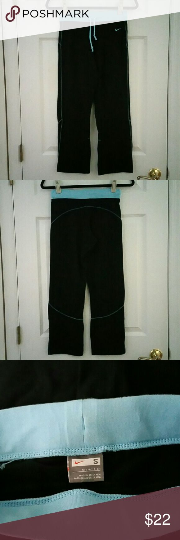 COMFY NIKE ATHLETIC/YOGA CROPS/CAPRI PANTS SM EUC! NIKE CUTE ATHLETIC CAPRI PANTS! LT BLUE WAIST w/DRAWSTRING, STRECHY, BLACK BOTTOMS w/LT BLUE STICHING ACCENTS AROUND PANTS!   SIZE: SMALL   EUC! Excellent Used Condition! Worn Less Than a Handful of Times. Only teeny visible wear is on the back of the inside of the top of pants (near tag) Gently Laundered & Hung to Dry!  92% Cotton & 8% Spandex  FAST SHIPPING! Same Or Next Day Shipping!!  No Smoking, Buy It Now, Bundle Discounts Available…