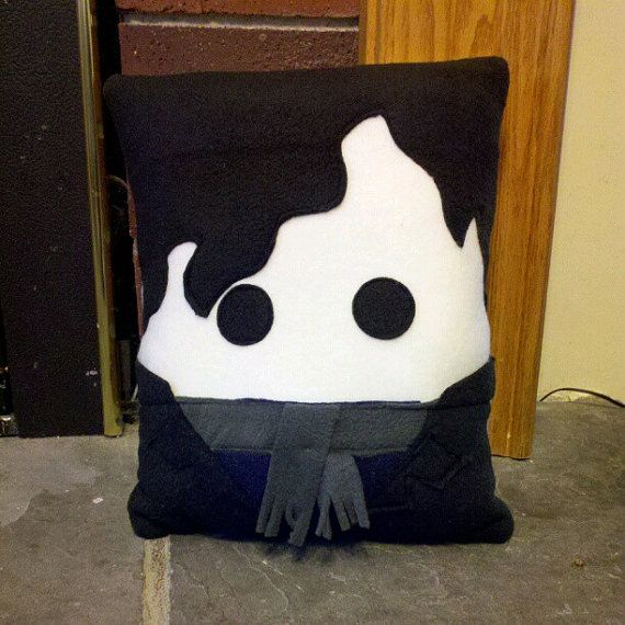 Sherlock Holmes plush pillow. Cute but the scarf should be blue.