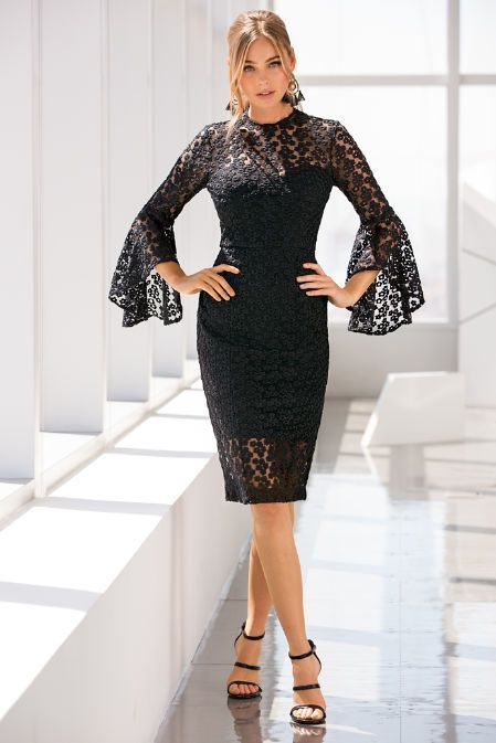 We have the perfect little black dress for your holiday soirees. Its our sexy sheath designed with dimensional daisy lace, a sweetheart neckline and asymmetric bell sleeves. P