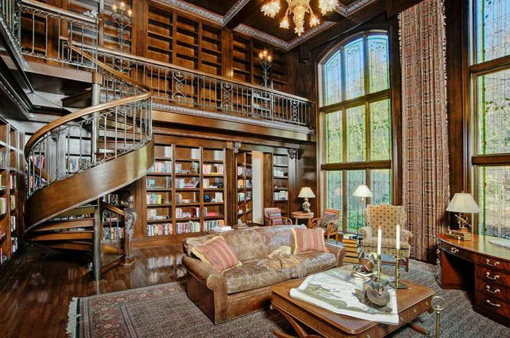 Hard wood antique home library with spiral staircase