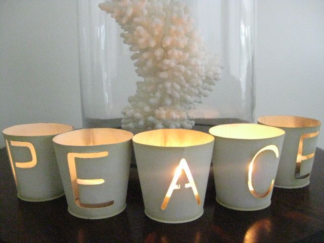 Beautiful candle holders for the Holidays. Stencil words on glass & spray paint.