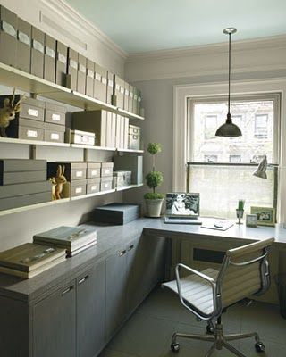 organized w/ same color storage boxes and files; hanging industrial light; a good chair - all in a small space