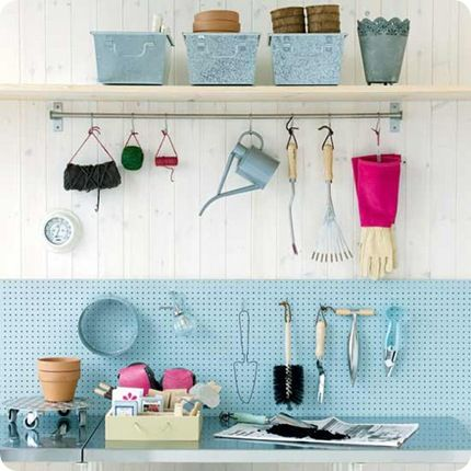 Painted pegboard to organize and bring in some colour in the garage.