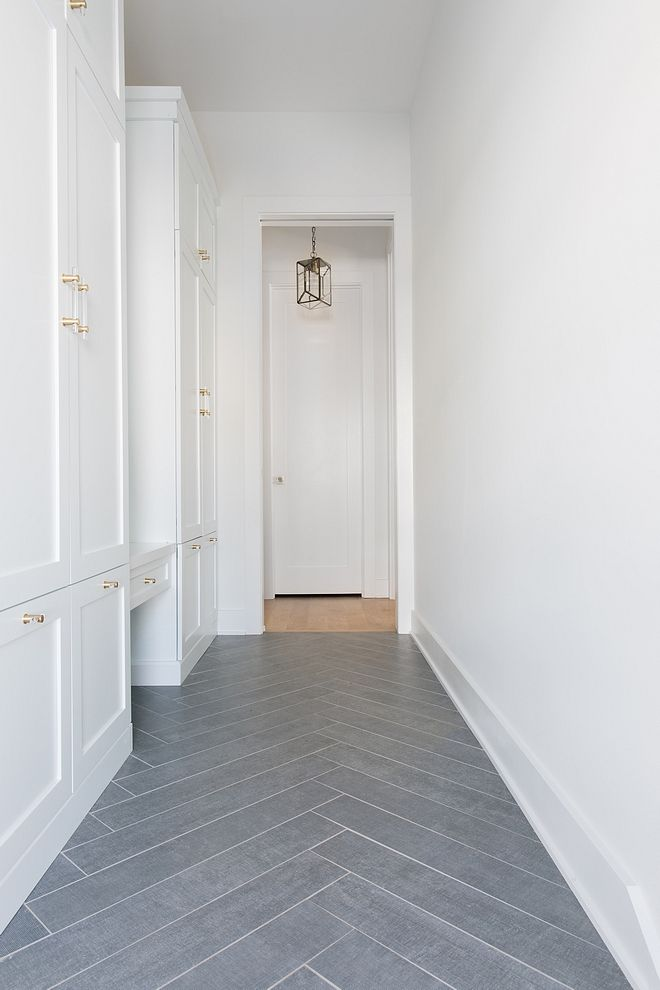 Mudroom Features Grey Tile In A Herringbone Pattern And White Cabinets Painted Sw Extra White Maybe Flooring Trends Mudroom Flooring Herringbone Tile Floors