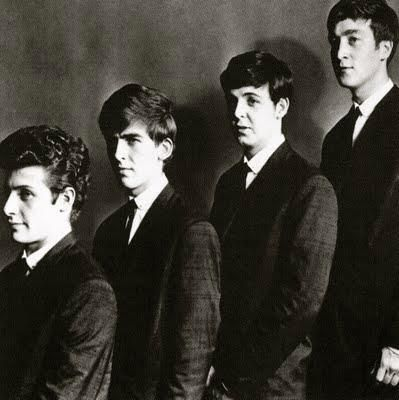 The Beatles before Ringo - that's Pete Best in the front of the line...George, Paul, John.