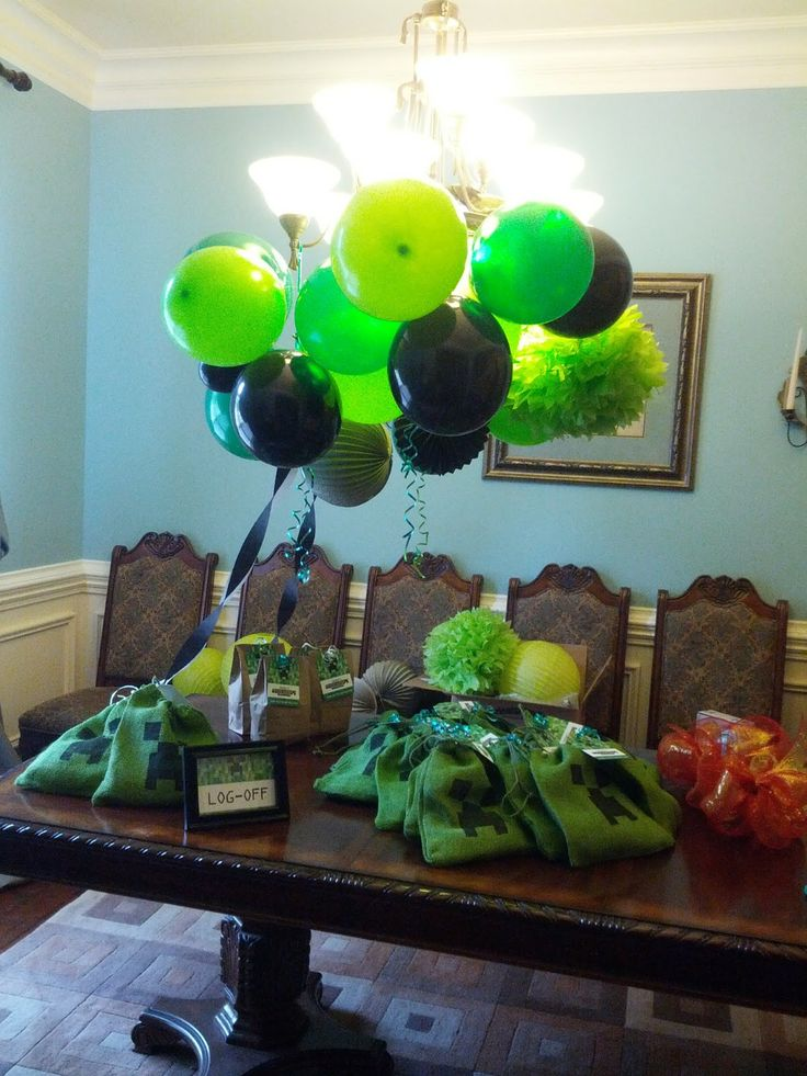 The Ultimate Minecraft Birthday Party decor! Balloons are the jam! I did this for my little man's birthday party! I make all kinds of custom invitations and party decor plus more for whatever your theme might be for your special baby's birthday! Contact me at info@fox-t.com. Thanks!