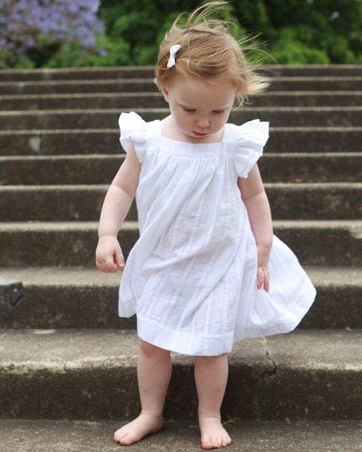 "Baby Isla having fun in her ""Amelie Dress"".  Handmade clothing for little girls."