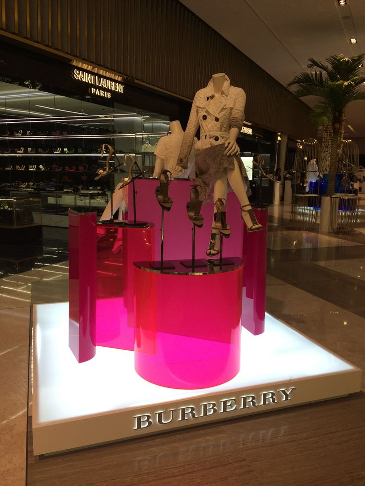 #Burberry Display at #Level Shoe District #DubaiMall 2015 #Magenta bent acrylic  podium