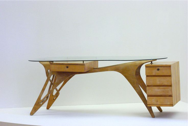 C. 1950~ amazing desk by Carlo Mollino. I love the beautiful organic lines and the cleanliness of it, the way the drawers are suspended out to the side with seemingly no effort. This is a gorgeous piece of furniture.