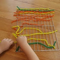 Pipe cleaners and cooling rack. What a great fine motor activity- Early Literacy Play Brilliant!