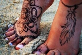 i like the feather tattoo on my foot but in color`