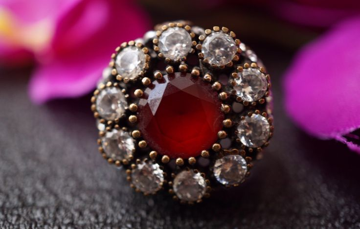 A personal favorite from my Etsy shop https://www.etsy.com/listing/474694204/diamond-ruby-ringsterling-silverantique