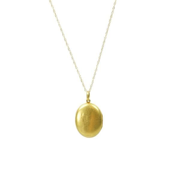 This 15k gold Locket has a beautiful rich yellow color. It is unusual to find a simple unadorned locket from this era, this is just a lovely simple oval. The lo