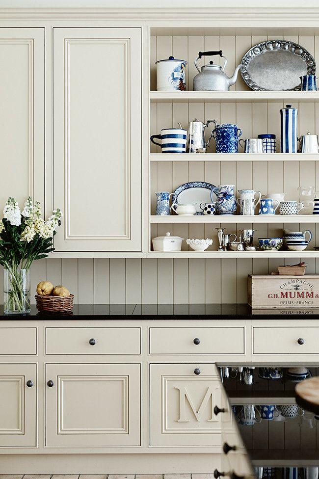 Cream cabinets, blue and white china, pewter, granite counters...