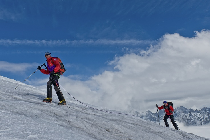 A mountain guide from Chamonix roped up with his client from UK, as seen on glacier Blanche, near Aiguille du Midi, Chamonix, France.