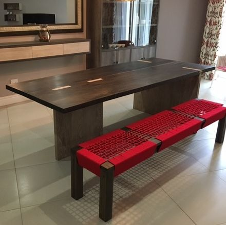 A Khumbula Dining Table and red rope Country Bench - designed with rock 'n roll in mind.