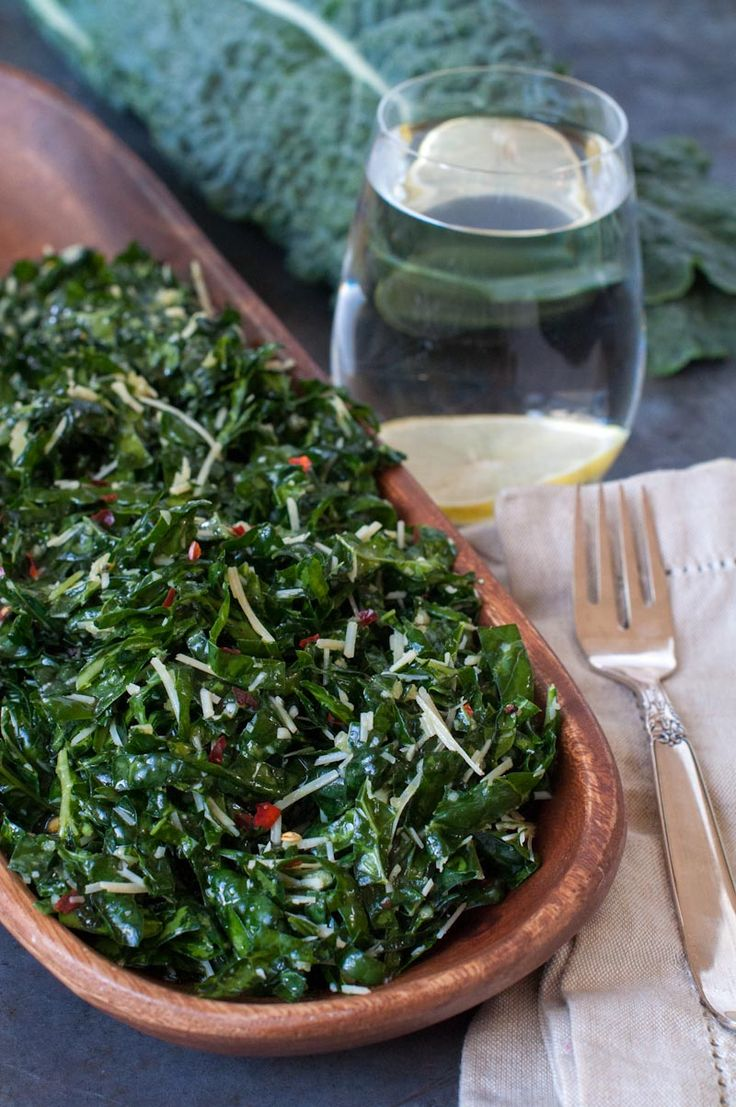 Lacinato Kale Salad - 1-2 bunches lacinato/dinosaur kale, de-stemmed and thinly sliced  3 tablespoons fresh lemon juice 3 tablespoons extra-virgin olive oil – I absolutely love this olive oil from Amphora 2-3 cloves garlic, minced pinch of fine or coarse sea salt – I adore this celtic sea salt, as it's unrefined and chock-full of minerals  pinch of freshly ground pepper pinch of red pepper flakes, to taste  2/3 cup shredded Parmesan cheese