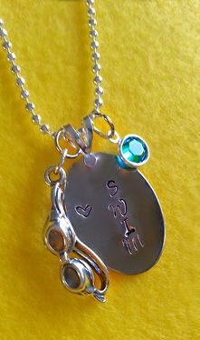 This cute hand-stamped SWIM necklace makes a perfect gift for that special swimmer in your life.