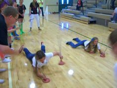 A super easy game for a rally or assembly. You just need a few plungers and have the kids lay on their stomachs and pull themselves across the floor in a race!   {Bishop Manogue High School, Reno}