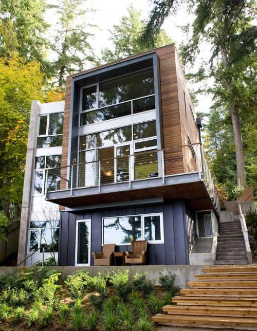 great use of an inexpensive resource. the charcoal colored siding is actually roofing panels,