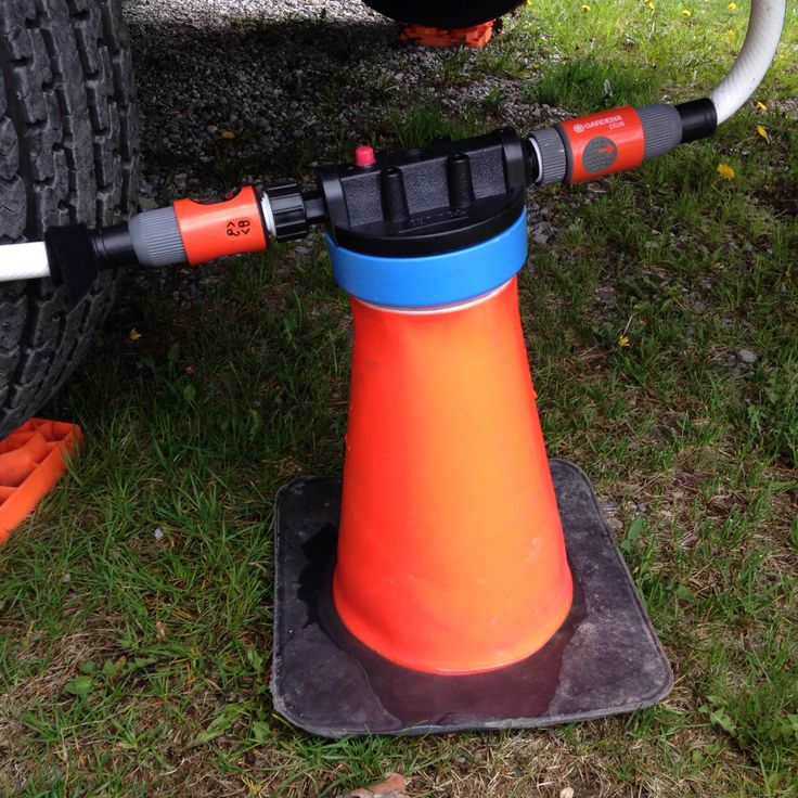 Make a stand for a canister style water filter by cutting a portion from the top of a small rubber pylon.