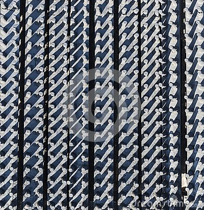 Abstract background of vertical patterned textured rubber.