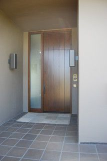 Modern wood front door with privacy side light window