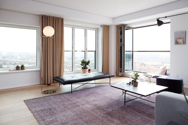 Chillout area on the 10th floor of 'Bohrs Tårn' in Copenhagen. HANDVÄRK Daybed and Coffee Table 90 are doing good in this stunning apartment.