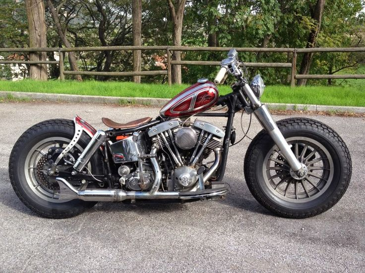 Shovelhead swingarm custom with 41mm bare fork lowers and 13-spoke mag wheels