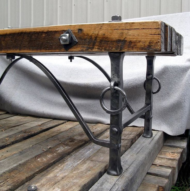 """Wayne Wagstaff, Metal artist. A closer detailed image of the ironwork legs and support bars. 1 ¼"""" square legs with tapered 5/8"""" support bars and 3/4"""" square cross braces. The split rings are ½"""" round by 3""""Ø. #blacksmith #metal  #blacksmithing"""