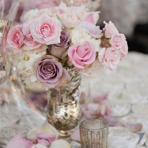 Jump on the 2014 wedding flower trend! Florists are single-handedly bringing the rose back by showing off the different varieties of roses available to get away from the cliche reputation.