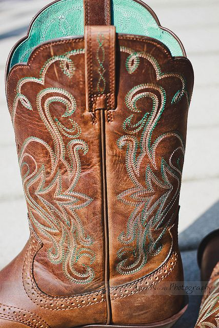 My bridesmaids are wearing cowboy boots ... so I'm thinking about it, too. Every Texas girl has to have a pair of cowboy boots!