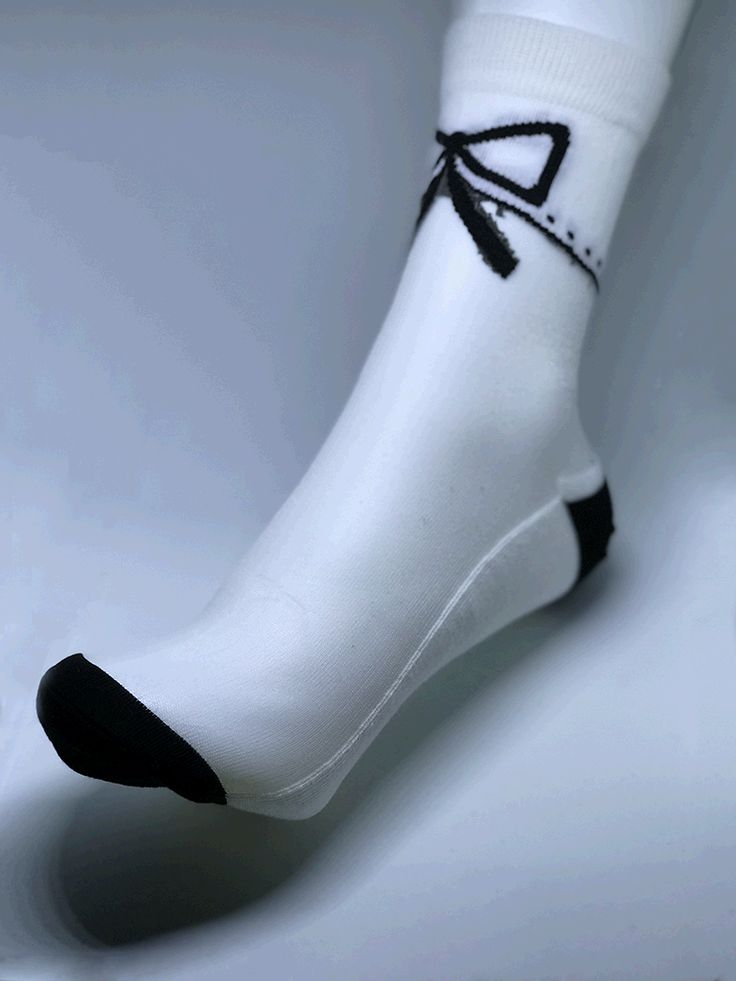 Women white trim with black bow. Pale top and white and black cotton bottom.